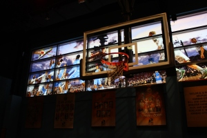 Kids (and adults) can shoot hoops while surrounded with some of the best college basketball images.
